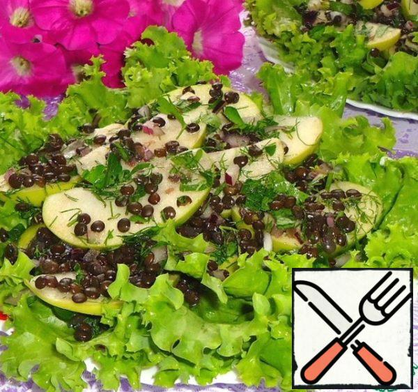 Serve salad on lettuce leaves. The salad turns out with a light spicy note, thanks to mustard.