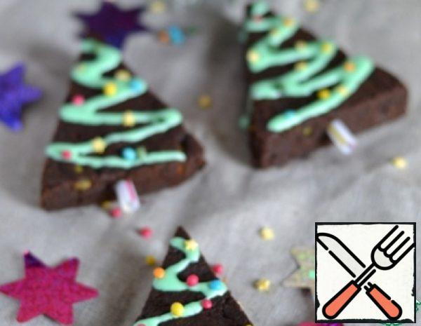 Shift the glaze in a pastry bag, make brownie patterns in the form of garlands. Decorate with confectionery sprinkles.