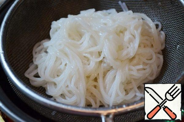While the seafood is marinated, boil the rice noodles according to the instructions on the package.