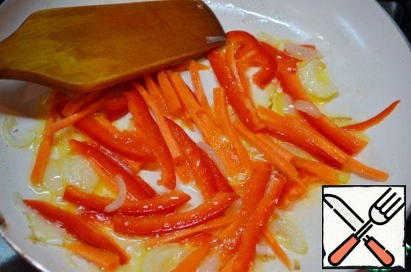 Then add carrot, pepper and garlic and fry for about 2 minutes.