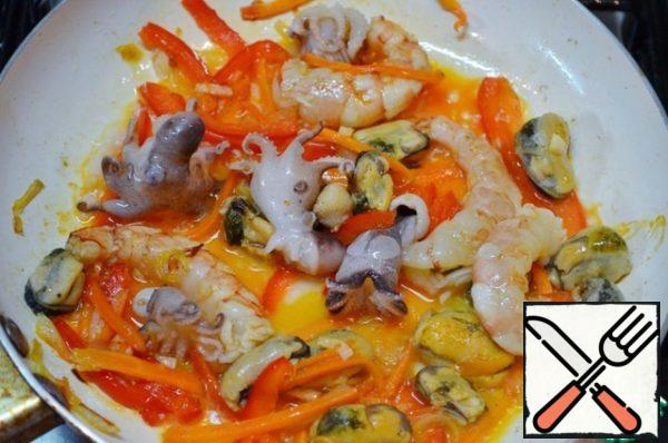 Add seafood and fry for about 5-7 minutes.