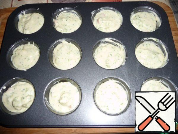 Form for muffins grease with oil and fill with mass.