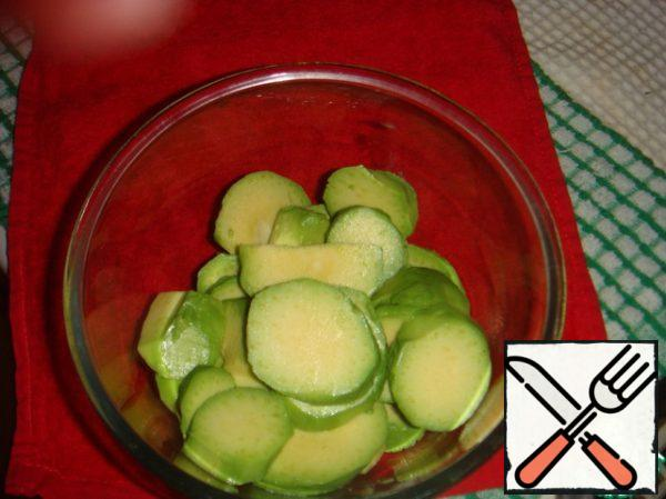 Fold the avocado slices into a container.