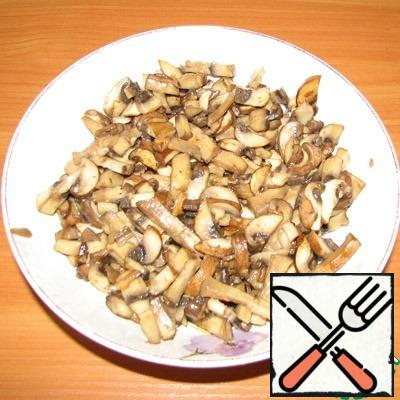 Fry the mushrooms until cooked in a small amount of olive oil.