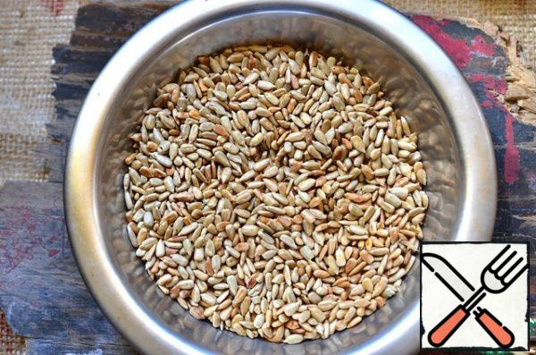 Fry sunflower seeds in a dry pan until Golden brown.