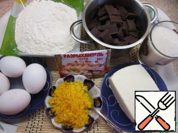 These are all the ingredients. Use a fine grater to remove the zest from the orange. Mix flour with baking powder.