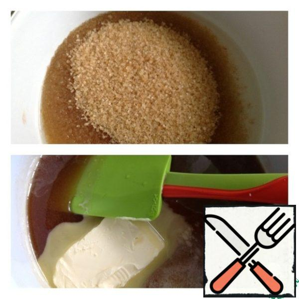 In the ladle pour 50 ml of water and add 2 stack of sugar. Cook caramel over low heat for 7 minutes. Add 50 grams of oil and brandy. Cook for another 5 minutes.