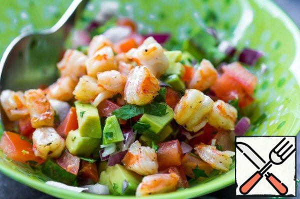 Mix chopped vegetables and warm shrimp.