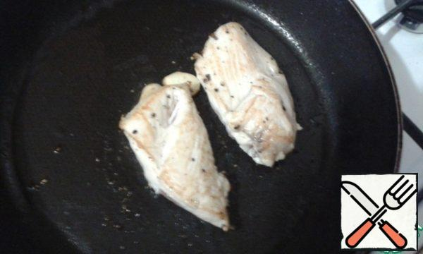 Season the chicken breast with salt and pepper and fry until tender.