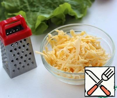 Grate the cheese.