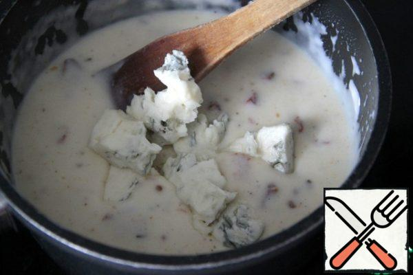 Remove from heat. Add in the hot sauce and the Gorgonzola, stir to dissolve cheese.