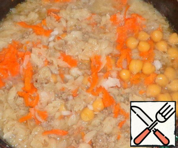 Add boiled chickpeas. Stir.