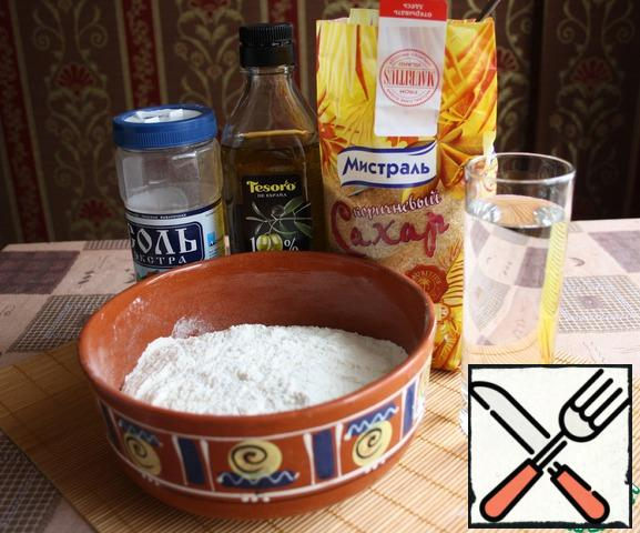 We will prepare the extract dough for our strudels. Mix flour, sugar, salt, water, add olive oil.