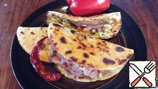 Serve immediately. Tortillas are delicious hot and cool very quickly. Prepare this quick and uncomplicated dish. I am sure that Your home will appreciate it. Bon appetit!