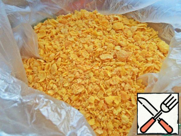 Unsweetened corn flakes break into crumbs through the bag. You can roll a rolling pin.