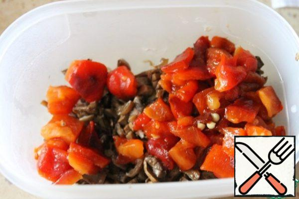 In the fried mushrooms add the diced roasted red pepper.