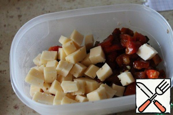 Then cheese cut into cubes. Stir.