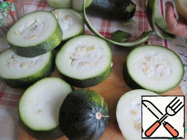 Take a large zucchini and cut it into round portions slices.