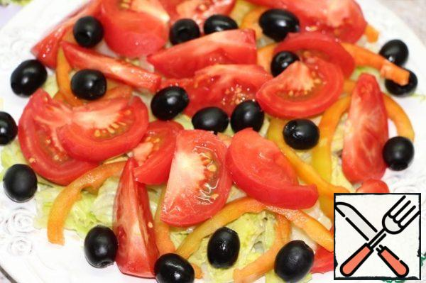 Then tomatoes, cut into slices and olives.