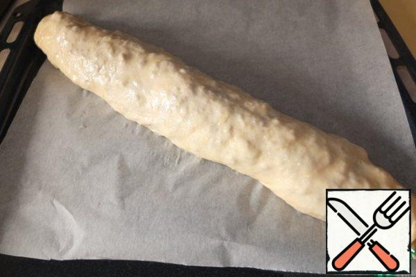 Turn off a thick roll and send it in the oven, heated to 180 degrees, for 30-35 minutes.