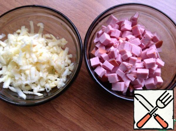 Peel and grate the Apple. Sausage cut into small dice.