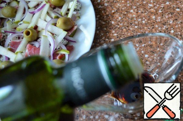 In remaining sauce into the olive oil, mix. Pour over the salad.