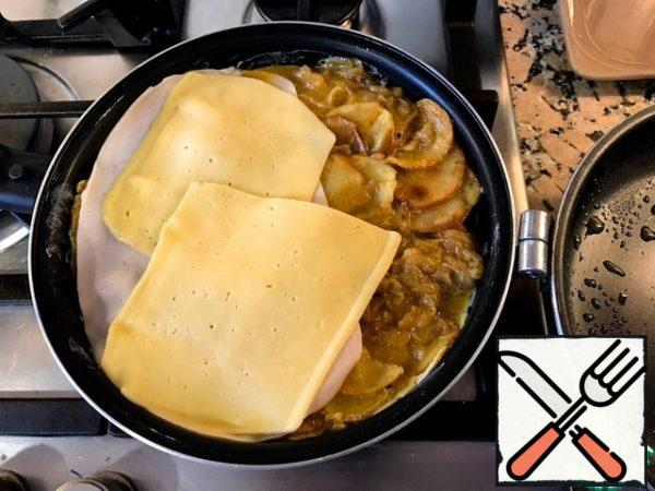 Beat eggs lightly, add salt and pepper to taste. Put the ready onions and potatoes in a bowl, pour the beaten eggs and stir well. Put half of the mixture in a frying pan, greased with olive oil, put slices of ham and cheese on top.