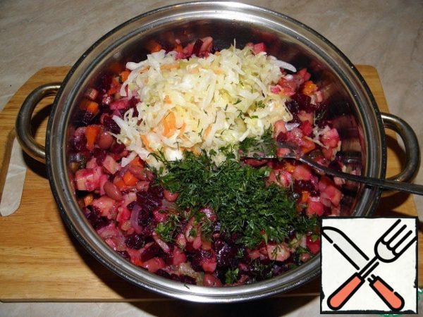 Add the sauerkraut and greens, mix again.