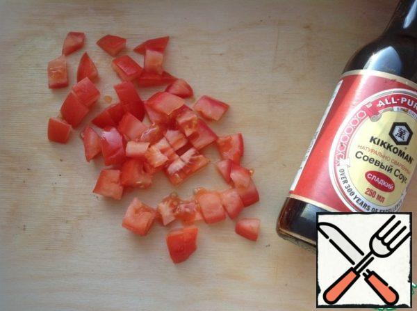 Wash tomatoes, cut into small cubes.