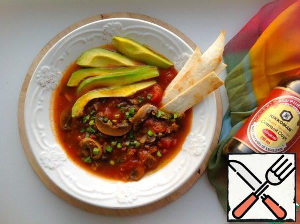 Pour the soup on plates, sprinkle with herbs, garnish with slices of avocado and crispy tortilla. Bon appetit!