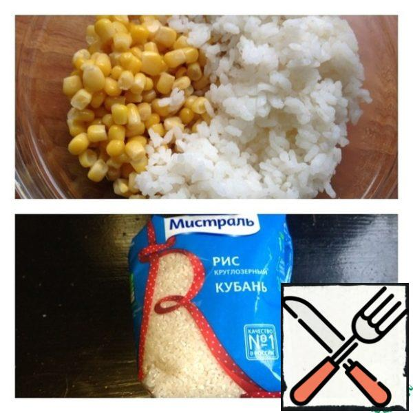 Rice pre-boil (according to the instructions on the package) and cool. Add to pepper rice and corn.