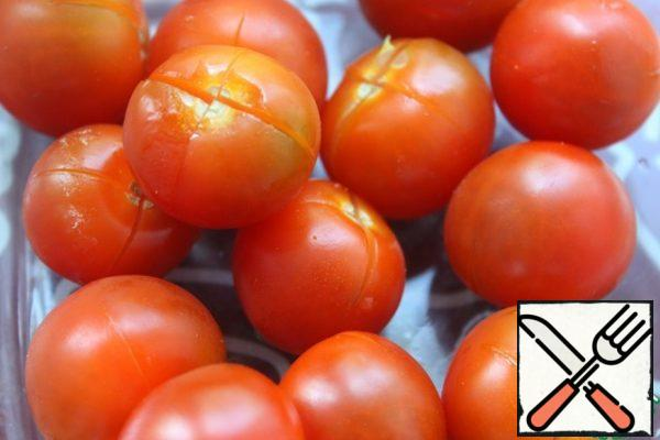 Have tomatoes to make cuts crosswise at the base.