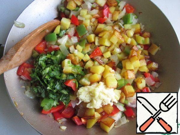 Then add fried potatoes, chopped cilantro and chopped garlic. Stir.