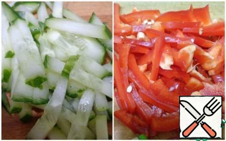 Cucumber and sweet pepper cut into strips.