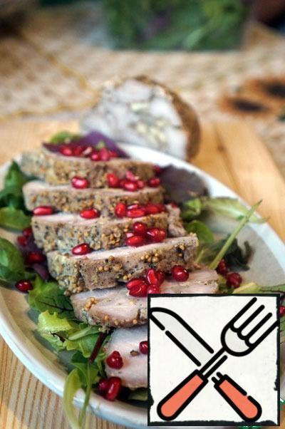 The finished pork cool slightly, cut into wide slices and serve on lettuce leaves, garnished with pomegranate seeds.