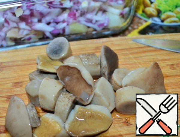 Marinated mushrooms to slice and add to salad bowl.
