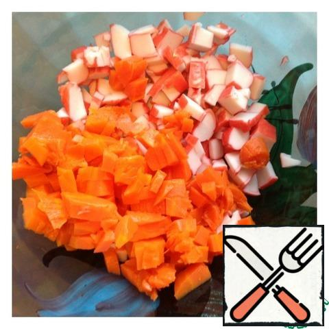 Peel the carrots and cut into a small cube like crab sticks.