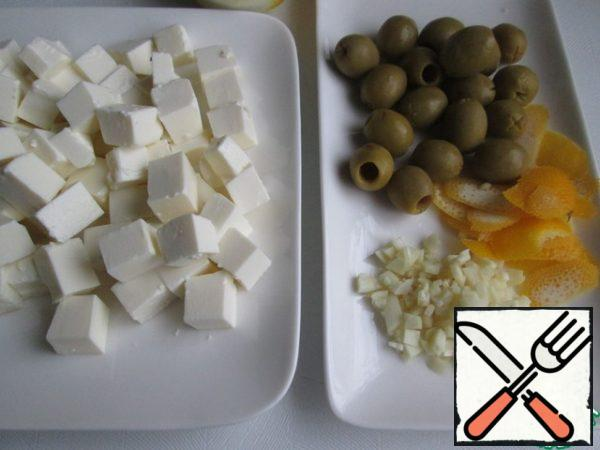 Feta cut into cubes. Vegetable peeler, cut the zest from the lemon. Garlic cut into cube, or plates of. Olives to get from the jar and drain off liquid.