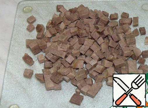 Boiled tongue cut into cubes.