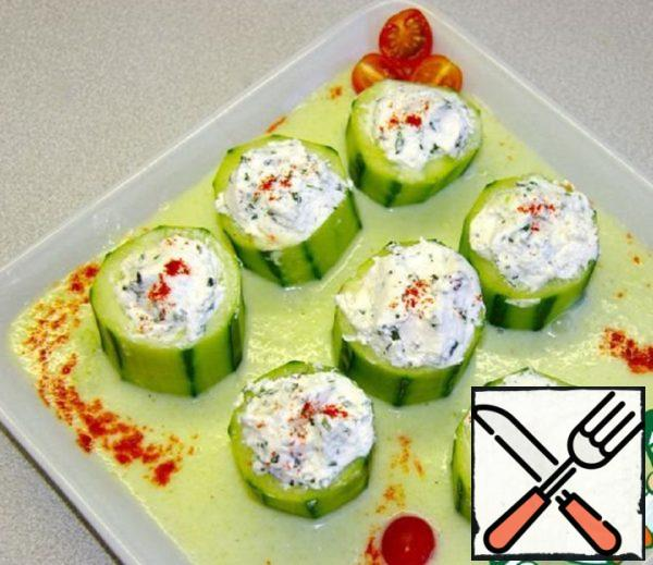Put our cucumbers in a plate, pour the sauce and decorate. Before serving, put in the refrigerator.