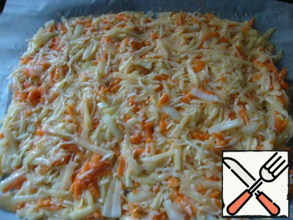 Preheat oven to 180 degrees. Cover the pan with paper, and put the vegetable mixture on top is not very thick.
