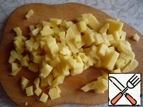 Peeled potatoes cut into small cubes.