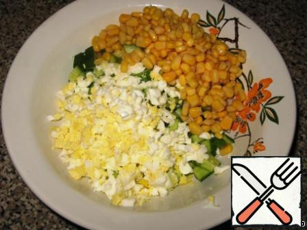 Add corn, of course without liquid. Corn must be sweet and juicy, bad corn can spoil the whole salad.