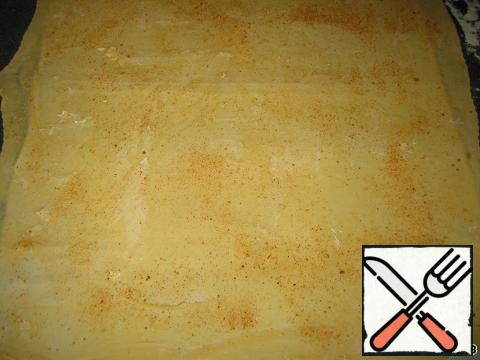 Lay the baking sheet with oiled paper. The dough brush with melted butter, sprinkle with bread crumbs.