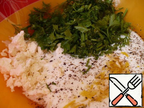 Mix in a deep bowl butter, zest, chopped herbs, yogurt and chopped cheese. Add  pepper.
