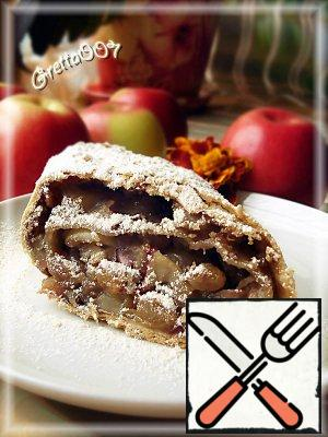 The dough is very fragile, so ready strudel leave a little breathe and cut into portions pieces warm. Before serving, the pie can be sprinkled with powdered sugar. Very tasty - from brown sugar. Serve the roll warm.