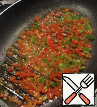 Remove the shrimp to the pan add the peppers, tomatoes and to stew.