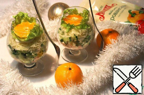 Top layer of cheese, lettuce on it and decorate with a slice of tangerines.