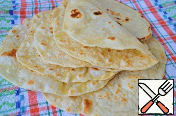 Tortillas ready, and now you can cook anything you want - burrito, tacos, fajitas or just put in a tortilla, greens, and cheese and enjoy! Keep in the bag, so as not to dry up! Bon appetit!