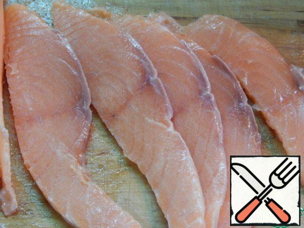 Fish cut across the grain into thin slices.